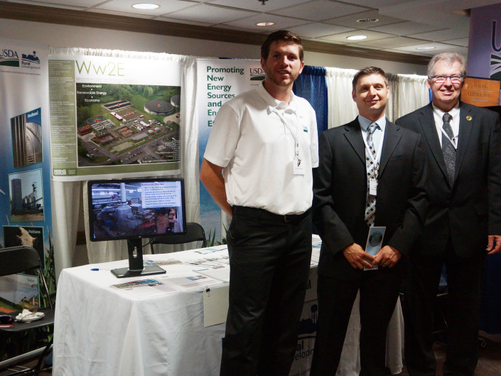 Peter J. Fisher of the USDA, HRG's Justin Mendinski, and Thomas P. Williams of the USDA exhibiting the MRSA Wastewater 2 Energy (Ww2E) Project at the 10th OECD Rural Development Conference in Memphis, TN.