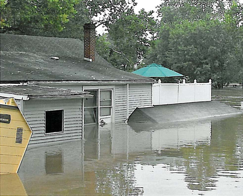 Gray house under water